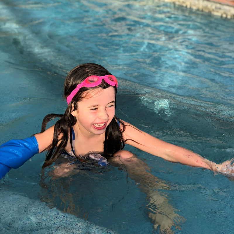 Francesca's daughter swimming with her short arm cast cover