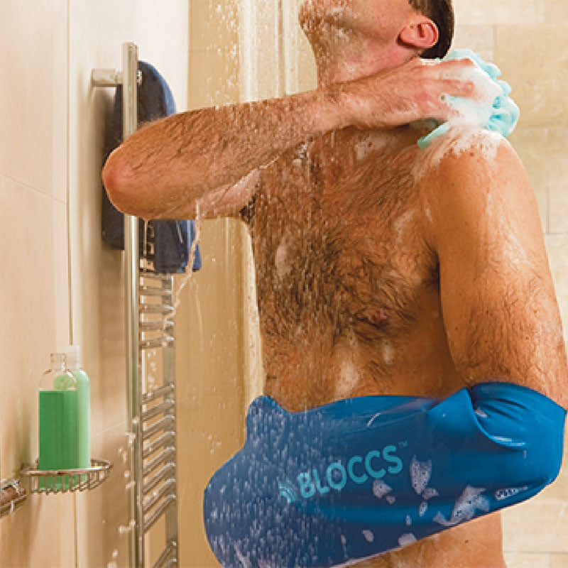 Man showering wearing a bloccs waterproof sleeve for arm cast