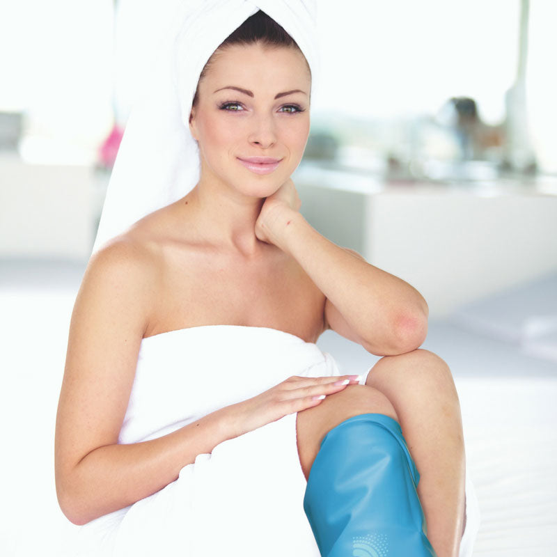 Woman wearing leg cast cover