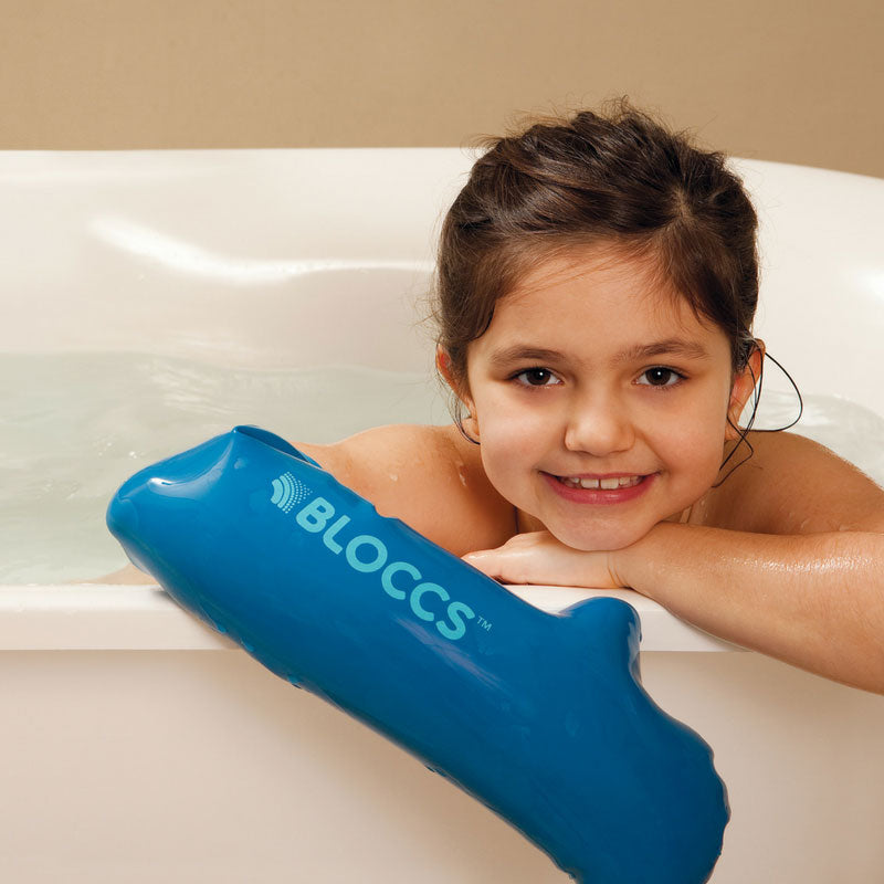 Girl wearing waterproof sleeve for arm cast