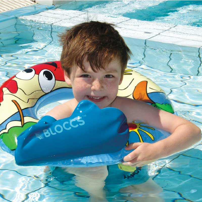 Boy wearing waterproof arm cast protector for swimming