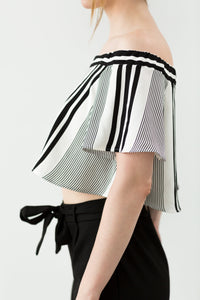 A chic and flowy off-shoulder top in white stripes. Slightly cropped