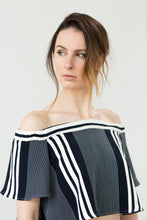 A chic and flowy off-shoulder top in navy stripes. Slightly cropped