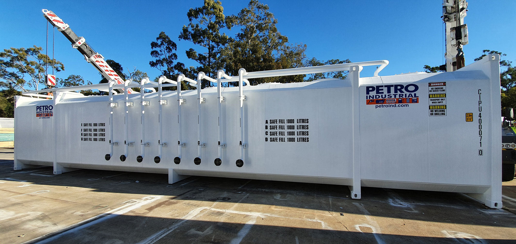 """Multi-Compartment Tank is fitted with 8 x 3"""" fill pipes with camlock fittings with spill containment units in place."""