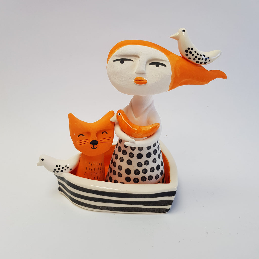 Windswept Lady and Cat Boat