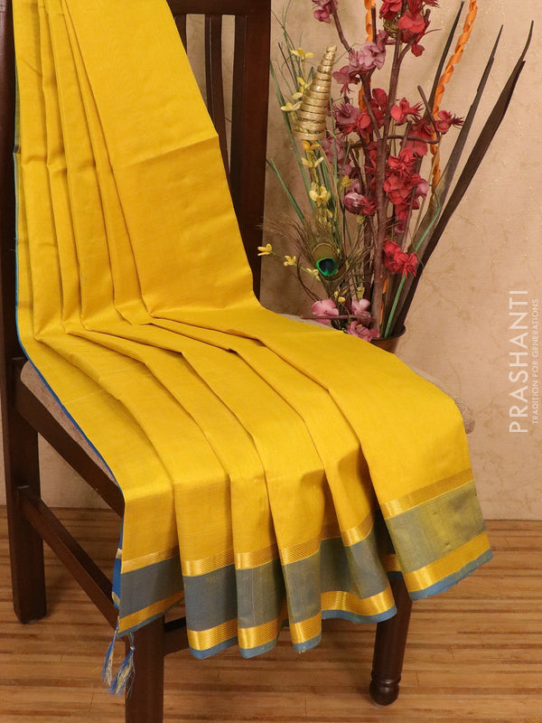 Silk cotton saree yellow and blue with plain body and zari woven rettapet border