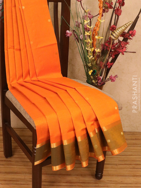Silk cotton saree orange and green with zari woven buttas and rettapet border
