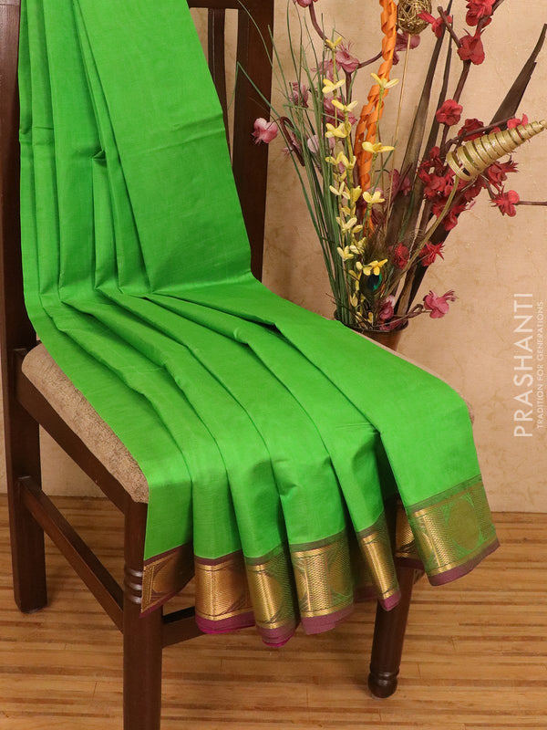 Silk cotton saree green and purple with plain body and zari woven border