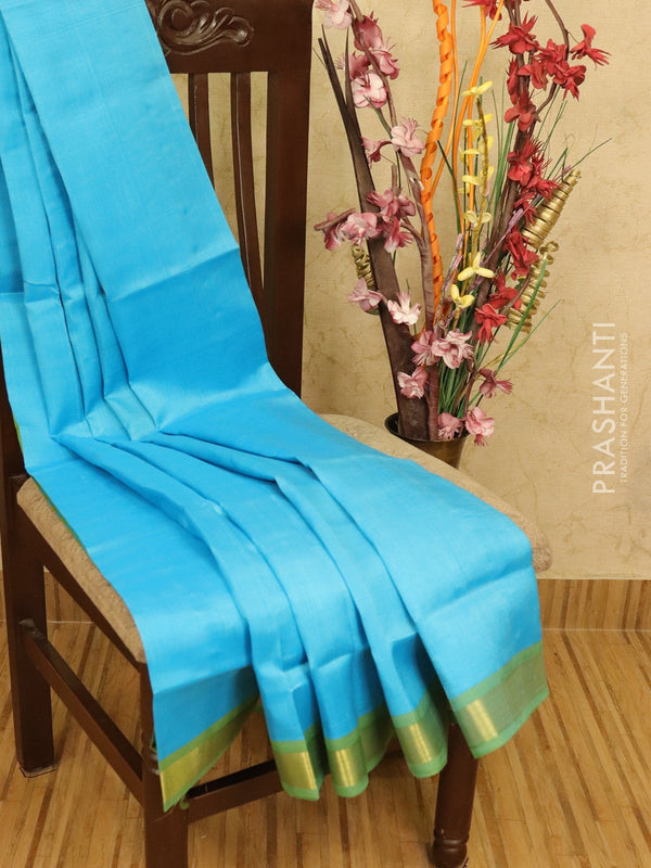Silk cotton partly saree light blue and light green with checked pallu and blouse with zari border