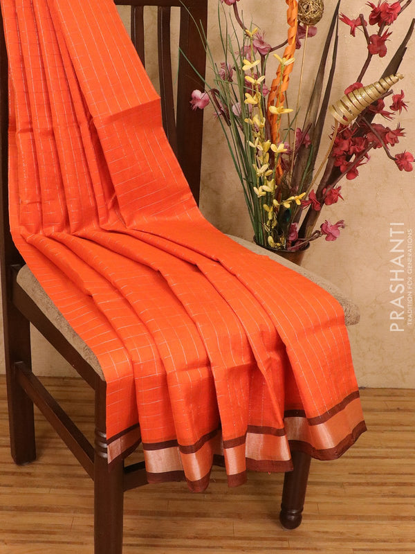Silk cotton saree orange and black with silver zari checks and zari border