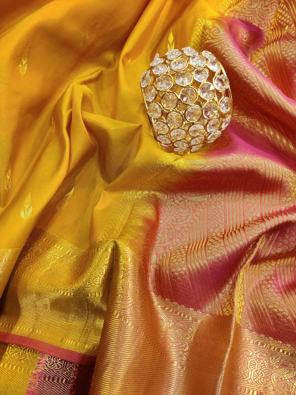 Pure kanchivaram silk saree yellow and pink with small zari buttas and rich zari border