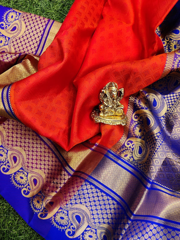 Pure kanchivaram silk saree orange and blue with allover self emboss and rich zari border