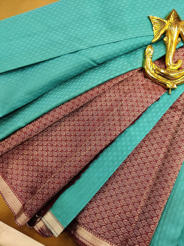 Pure kanchivaram silk saree light blue and wine with allover self emboss and simple silver zari border
