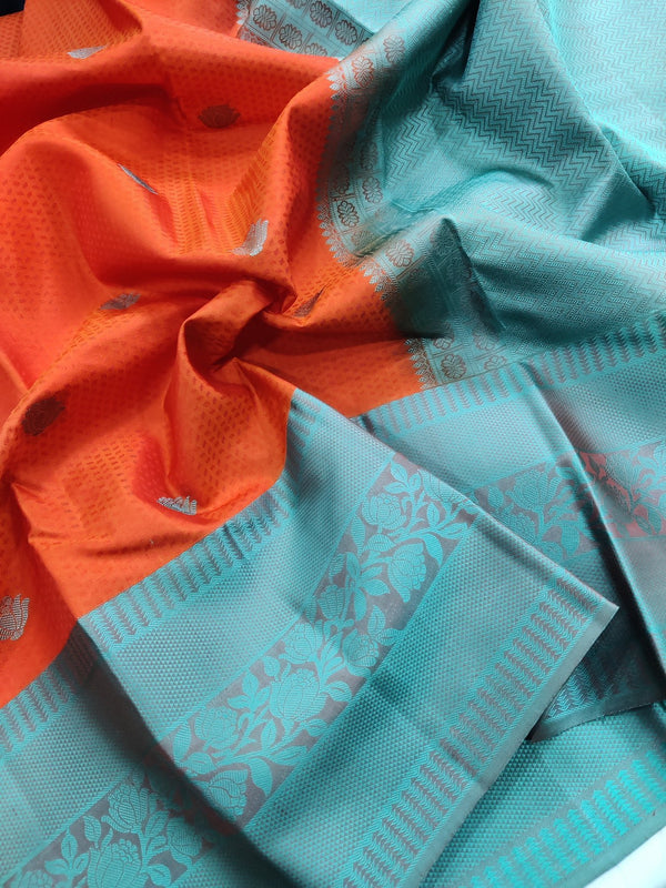Pure kanchivaram silk saree orange and teal with allover self emboss and thread buttas with thread woven border