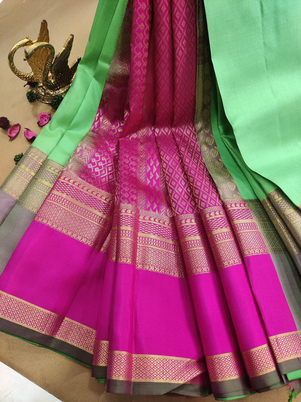 Pure kanchivaram silk saree green and pink with plain body and zari woven rettapet border