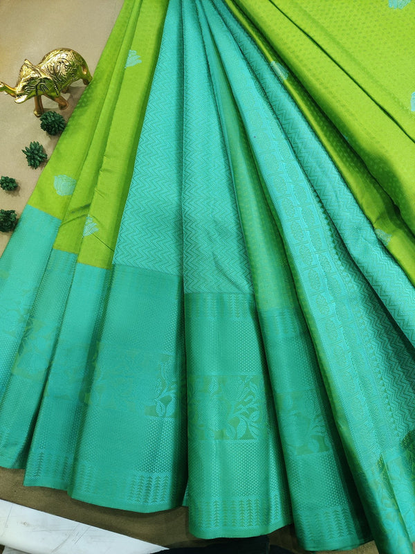 Pure kanchivaram silk saree light green and teal with allover self emboss and thread buttas with thread woven border