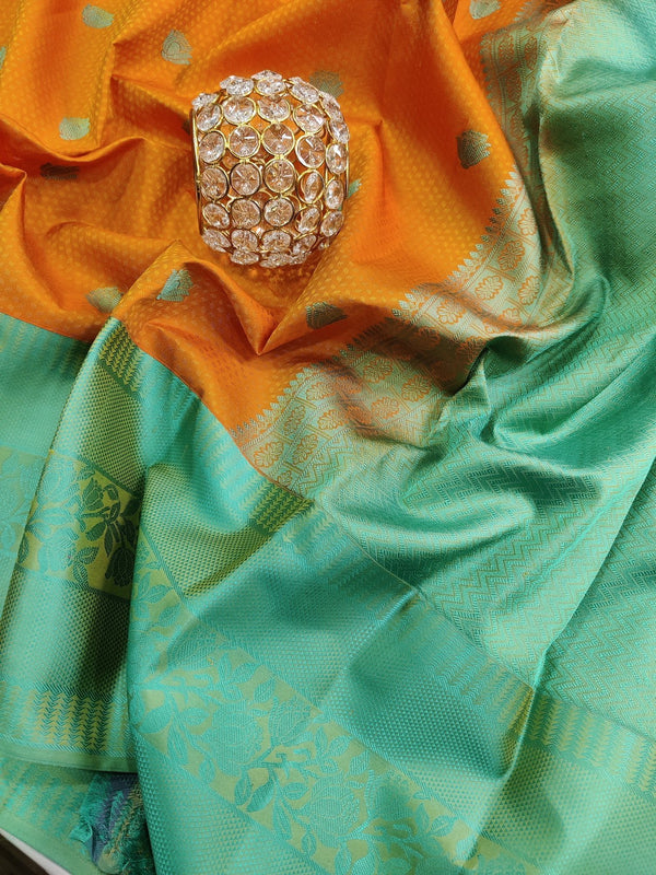 Pure kanchivaram silk saree yellow orange and teal with allover self emboss and thread buttas with thread woven border