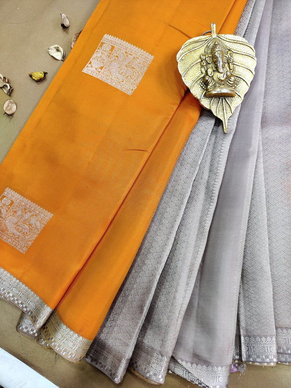 Pure kanchivaram silk saree orange and pastel shade with silver zari box buttas and simple zari border