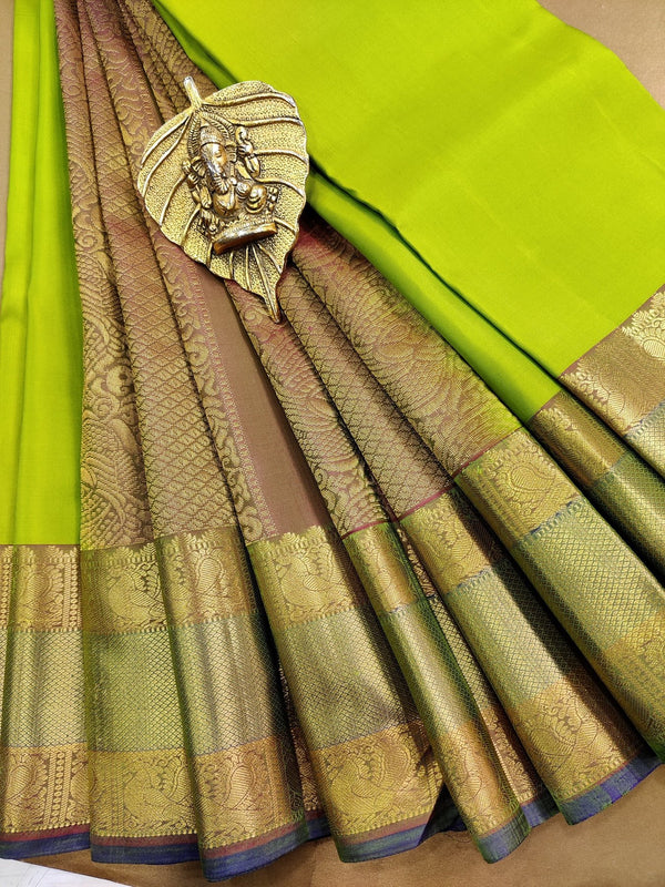 Pure kanchivaram silk saree green and dual shade of pink with plain body and rich zari border