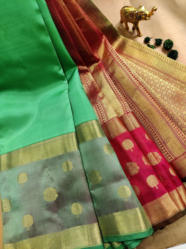 Pure kanchivaram silk saree green shade and pink with plain body and zari woven butta rettapet border