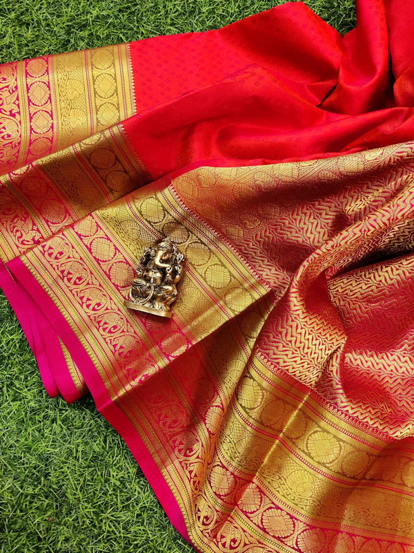 Pure kanchivaram silk saree dual shade of orange and pink with allover self emboss and rich zari woven border