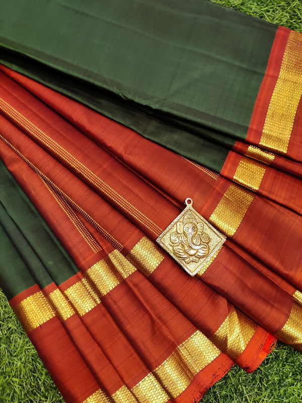 Pure kanchivaram silk saree green and rust with plain body and zari woven rettapet border