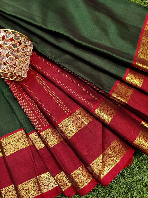 Pure kanchivaram silk saree bottle green and maroon with plain body and zari woven rettapet border