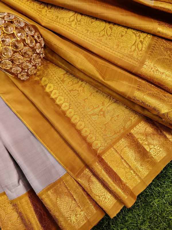 Pure kanchivaram silk saree grey and mustard with plain body and zari woven border