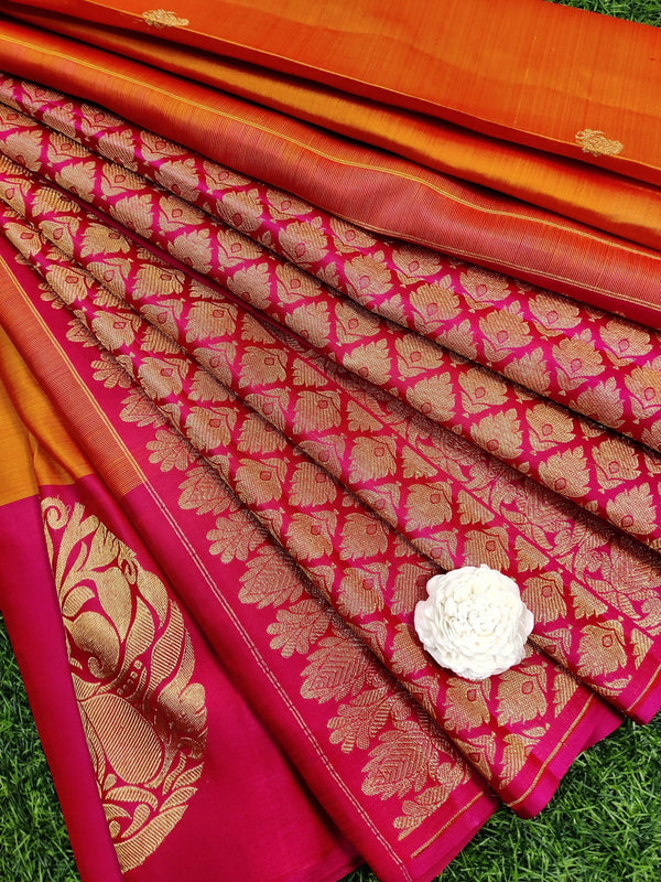 Pure kanchivaram silk saree dual shade of orange and pink with small zari buttas and zari butta border