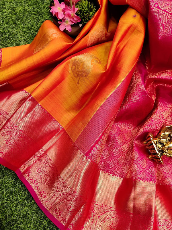 Pure kanchivaram silk saree dual shade of orange and pink with copper zari buttas and rich zari woven border