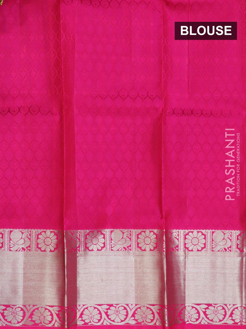 Pure silk pavadai material green and pink with allover self emboss and zari buttas with silver zari border for 3 to 5 years