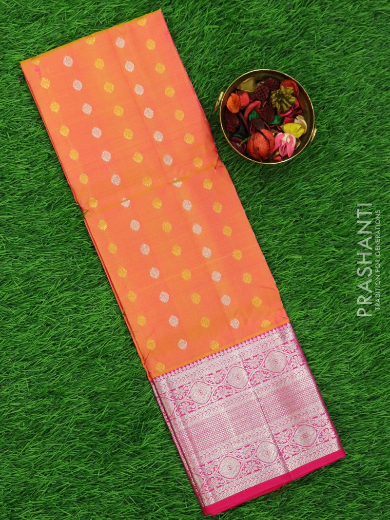 Pure silk pavadai material dual shade of peach and hot pink with allover zari buttas and rich zari borderfor 3 to 5 years