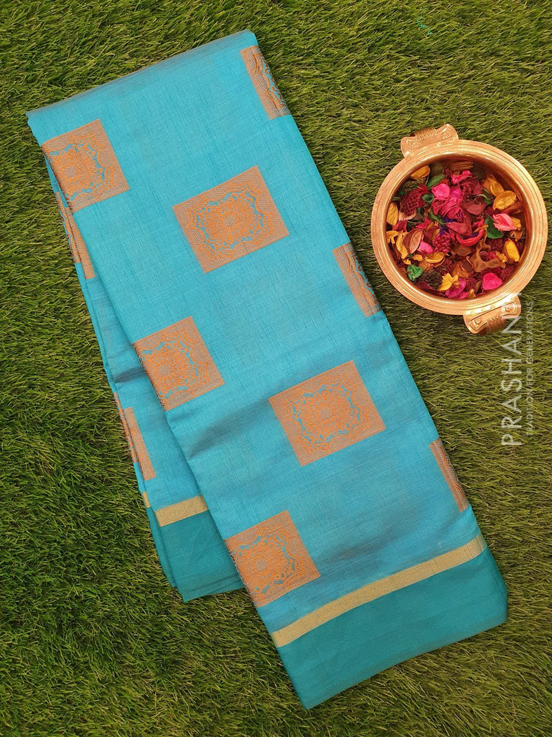 Semi raw silk saree blue with simple border and thread buttas