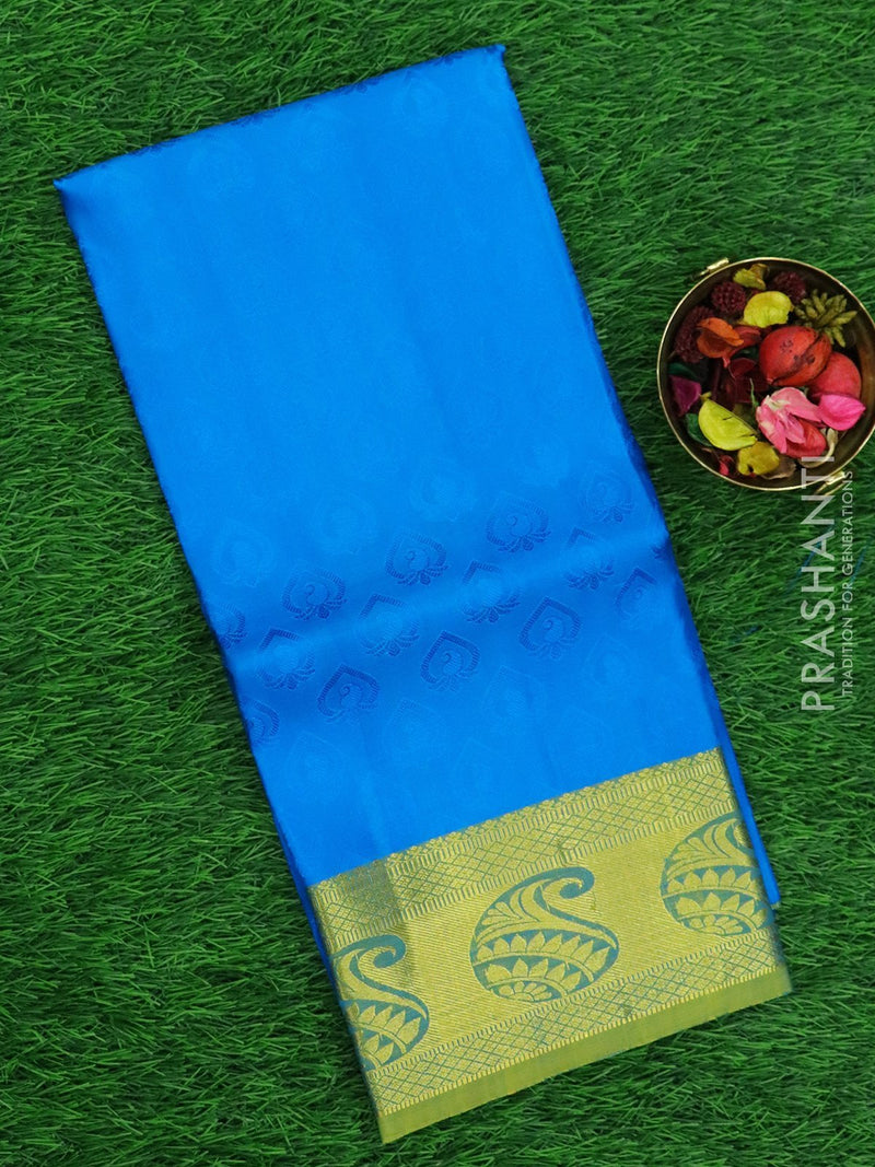 Pure silk pavadai material cs blue and green with allover self emboss and rich zari border for 6 to 10 years