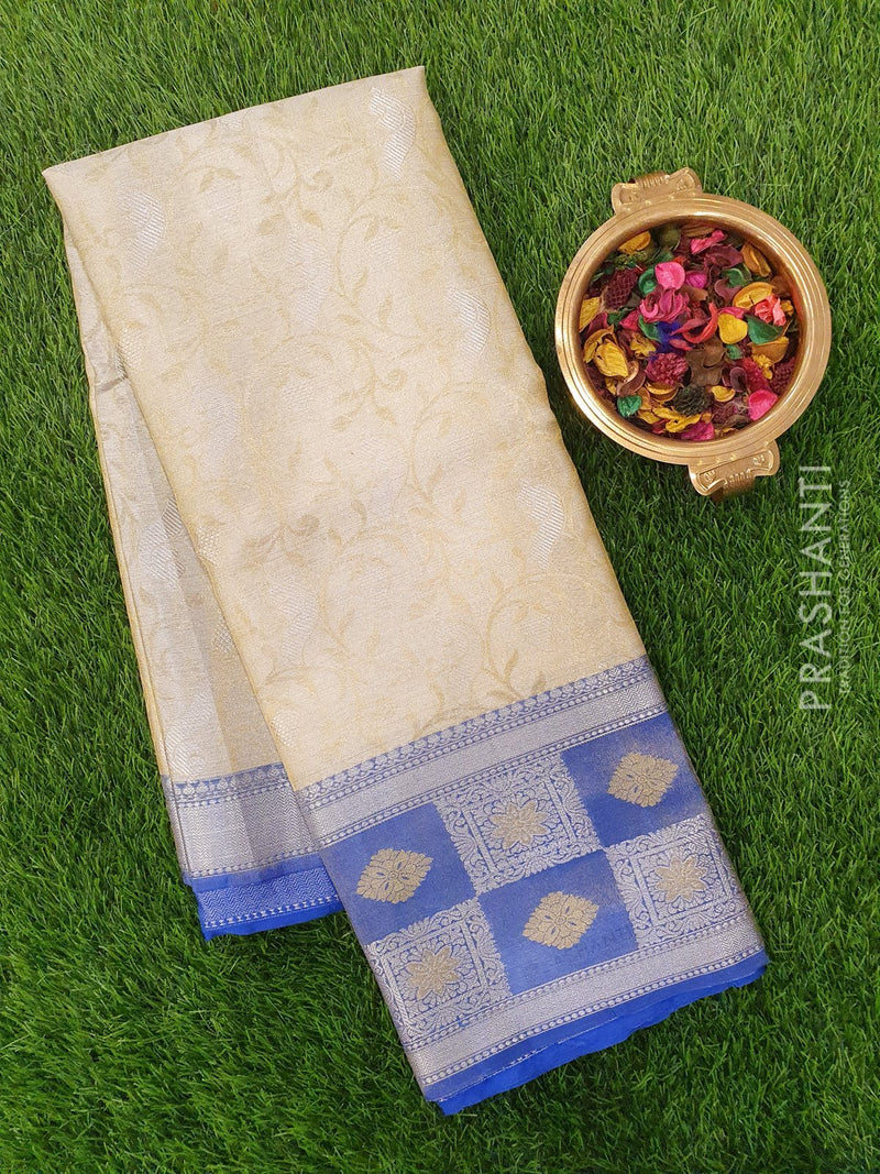 Tissue Banarasi Saree yellow tissue and blue allover self emboss with zari and thread woven border