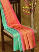 Pure Kanjivaram silk saree light blue and pink with gold and silver grouped buttas in borderless style