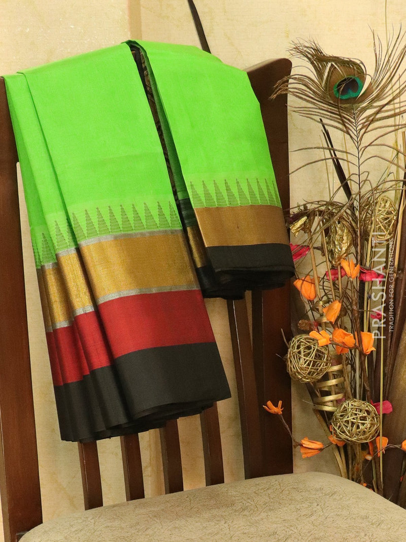 Kuppadam Silk Cotton Saree green and black with simple zari woven temple border