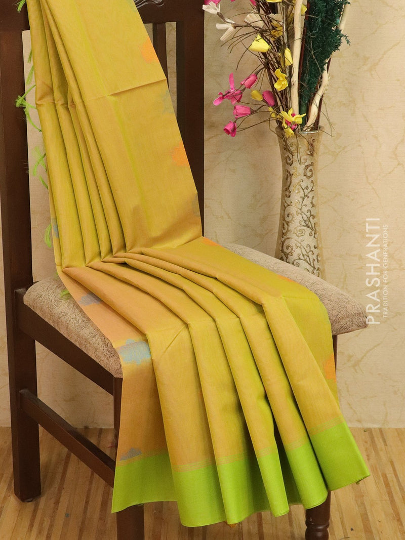 Kora silk cotton saree dual shade of light green with woven buttas and rich pallu