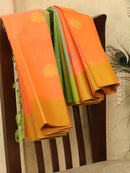 Kora silk cotton saree peach orange and green with woven buttas and thread pallu