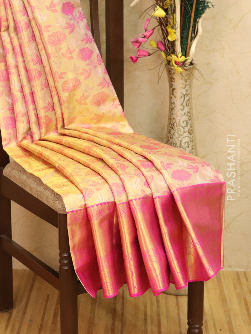 Pure Kanjivaram silk saree golden tissue and pink with allover floral zari weaves and rich zari woven long border