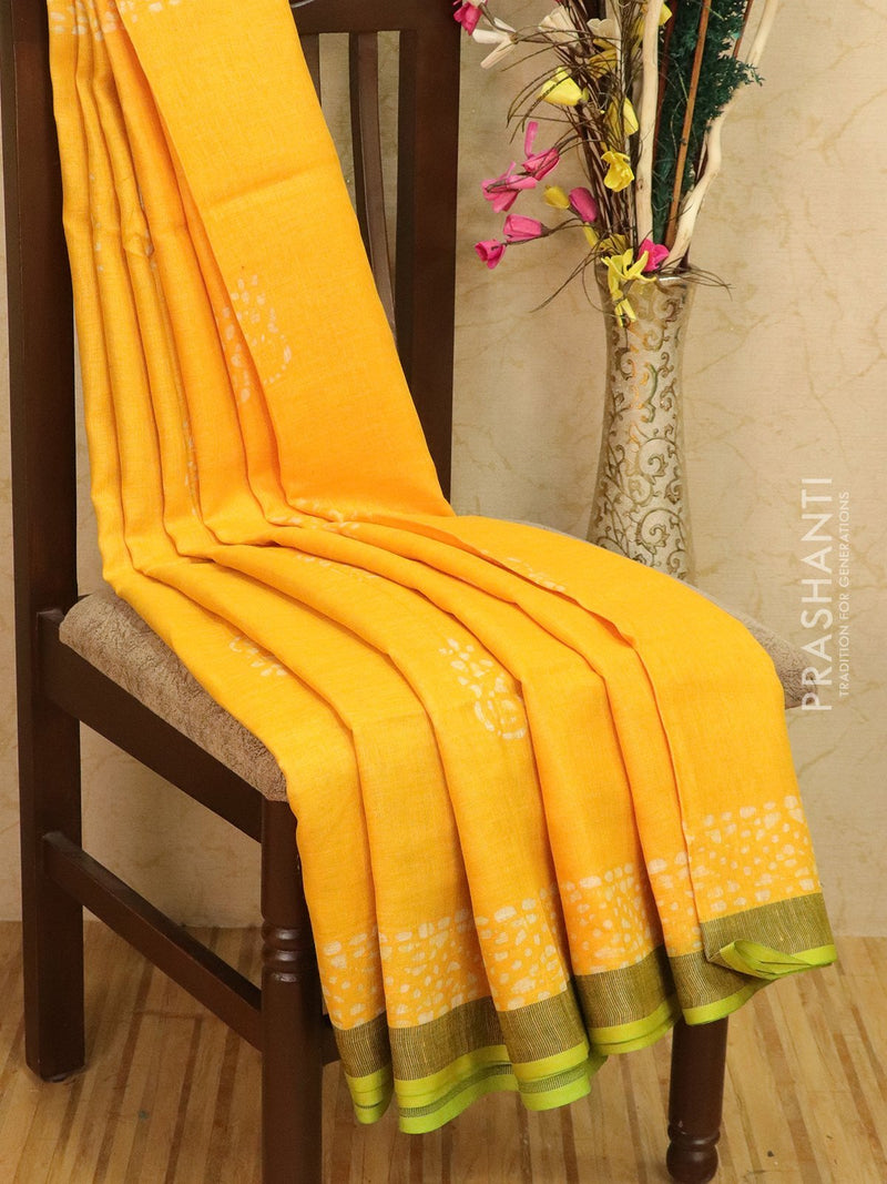 Pure linen saree yellow and green with batik prints and simple border