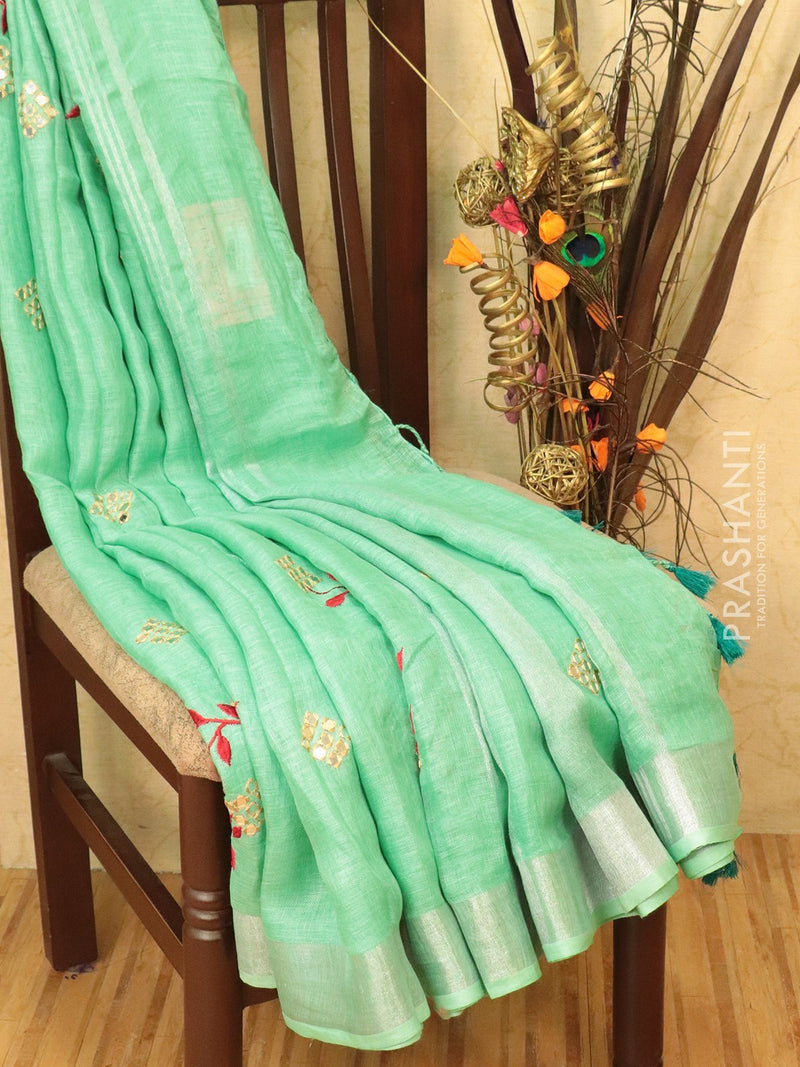 Pure linen saree light green with mirror work and simple border