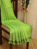 Pure linen saree green with mirror work and simple border