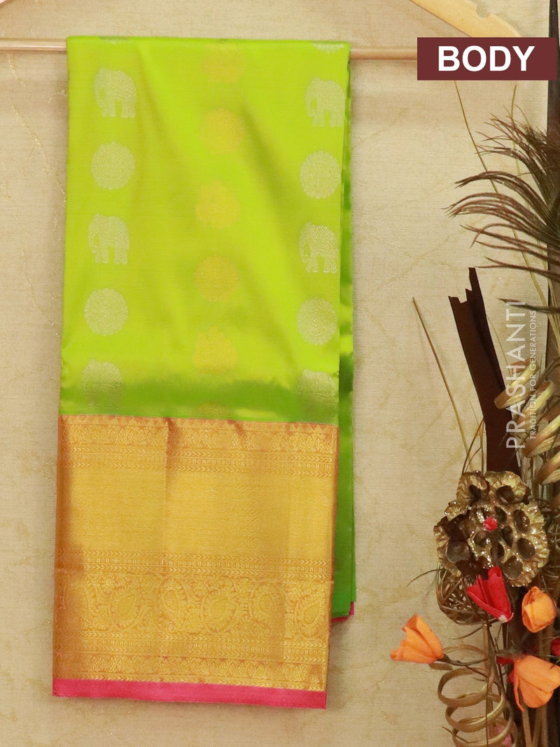 Pure Kanjivaram kids lehanga light green and pink with allover zari buttas and rich woven border for 6 to 10 years
