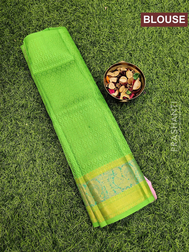 Pure Kanjivaram kids lehanga pink and green with allover self emboss and buttas with woven border for 0 to 2 years