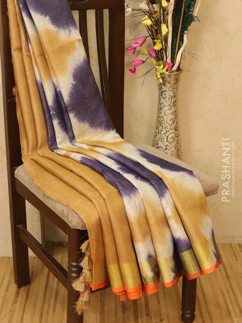 Pure linen saree beige and blue with batik prints and simple border