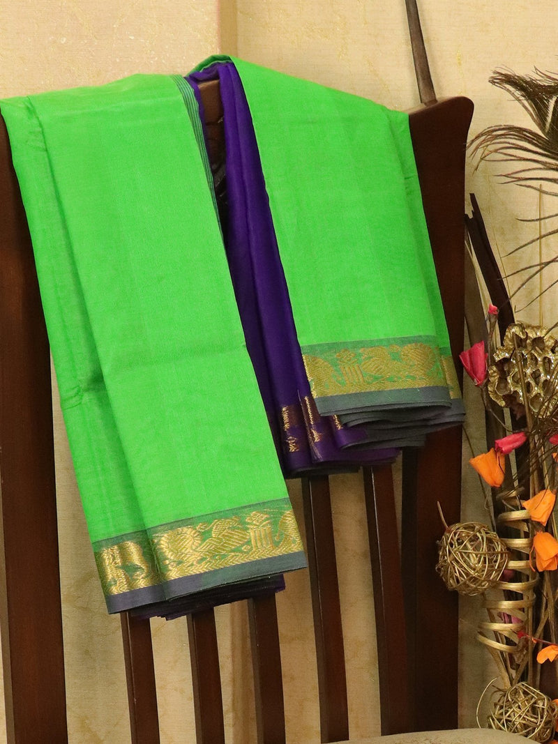 Silk cotton saree green and blue with zari woven simple border