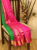 Silk cotton saree green and pink with zari woven border