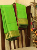 Silk cotton saree green and maroon with rich zari woven border