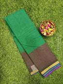 South kota saree green and pink with simple border and self emboss pattern